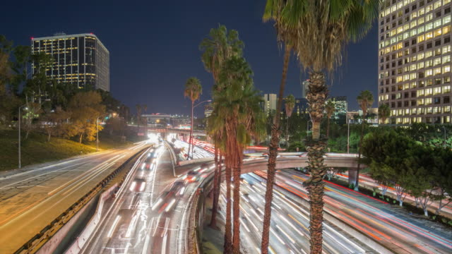 busy traffic through modern city at night in los angeles,timelapse,4k
