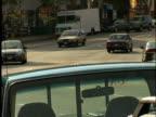 Busy Traffic Turns Corner (North America)