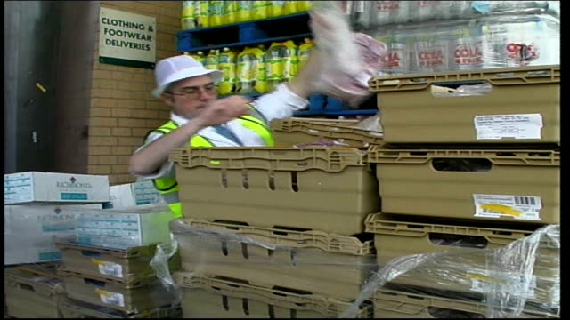 Butcher counter at Asda supermarket SCOTLAND Glasgow Asda Supermarket EXT Forklift unloading crates from Asda lorry / side of Asda lorry Vacuum...