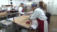 Butcher Packaging Meat at Whittingham Meats on December 26 2013 in Chicago Illinois