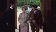 MS Butler opening doors for Maud Cunard and Sir Bache to entering in Nevill Holt / United Kingdom