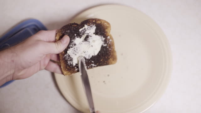 Butter on a piece of burnt toast