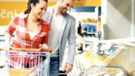 Buying food in supermarket