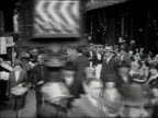 ca. 1929 - 1930 B/W WS CS POV People walking on city streets / Paris, France