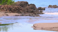 Cabagan, Cuba: water flowing, beauty in nature with gentle waves crashing at the mouth of the River Cabagan.