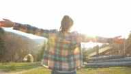 Cabin Retreat - Young woman enjoying life.