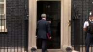 London Downing Street EXT Police officer standing outside Number 10 / Robert Halfon MP arriving / Greg Clark MP arriving / Michael Fallon MP arriving...