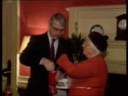 Cabinet decision on public spending cuts ENGLAND London Downing Street No 10 MS Woman pinning poppy to PM John Major's lapel as the 2 then stand for...