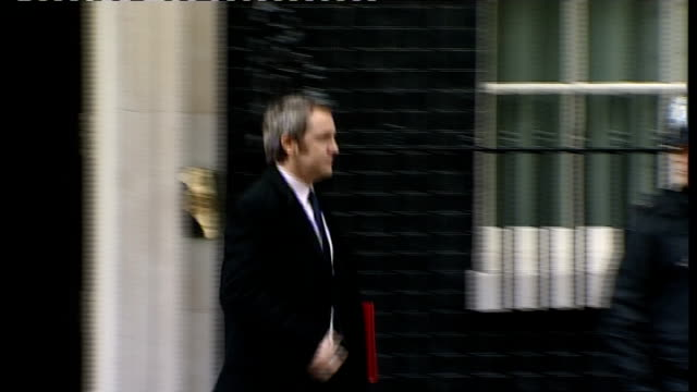 Cabinet meeting arrivals and departures James Purnell MP out from number 10 and away PAN to Geoff Hoon MP walking down Downing Street as stops and...