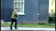 Departures ENGLAND London Downing Street EXT Departures from Number 10 following Cabinet meeting including Danny Alexander MP bumps head on car door...