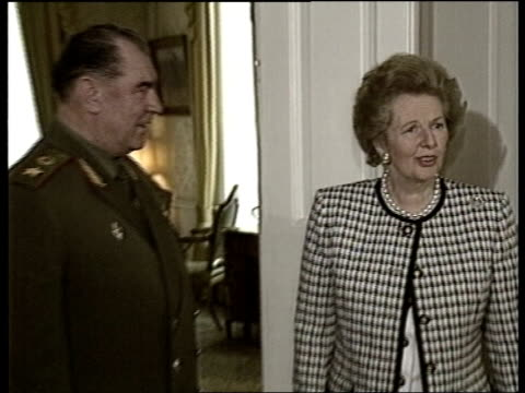 London Downing Street Margaret Thatcher LR followed by Soviet Armed Forces Min Dimitri Yazov PAN LR as they stand for photocall CMS Thatcher PULL OUT...