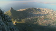 WS PAN HA Cable car descending from Table Mountain, cityscape with Table Bay in background / Cape Town, Western Cape, South Africa