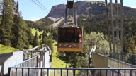 MS Cable way leaving to bring people on top of Seceda cliff on Italian Dolomites / Selva di Val Gardena, Italy