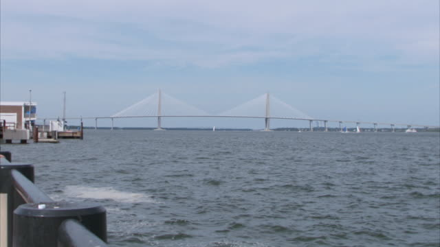 ZI Cable-stayed Arthur Ravenel Jr. Bridge spanning across ocean / Folly Beach, South Carolina, United States