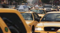 Cabs crowd at the turn at 8th Ave and Columbus Circle.  A long telephoto down 8th.