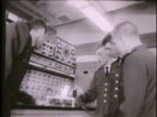 Cadets in astronautics aeronautics classrooms looking at experiment adjusting knob on panel Fairchild Hall Colorado CO Rampart Range