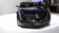 A Cadillac ELR gas and electric hybrid automobile produced by General Motors Co is plugged in while on display during the Connected Car Expo at the...