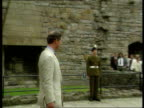 Prince of Wales Welsh tour WALES Caernarvon Castle Two soldiers standing on castle battlements play fanfare SOT LMS SIDE Prince Charles and Lord...