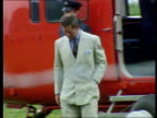 Prince of Wales Welsh tour WALES Caernarvon Helicopter touching down in field CMS SIDE Pilot sticks small Prince of Wales flag in door of helicopter...