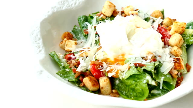 Caesar salad with fresh vegetable and egg in white bowl - Healthy food style