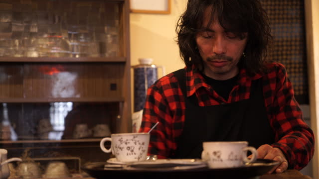 Cafe owner working in their own cafe