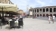 MS Cafes and Restaurants at Piazza Bra and Tourists roaming in front of Arena di Verona / Verona, Veneto, Italy