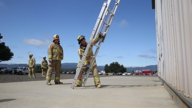 Cal Fire firefighters participate in a training session on May 27 2015 in Napa California Cal Fire firefighters are training ahead of what is...