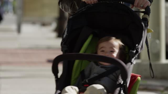 USA, California, San Francisco, Smiling boy (2-3) in stroller