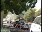 Santa Barbara beach / Los Angeles Burbank Cars along to Warner Bros Studio security checkpoint/ Close up of Warner Bros sign