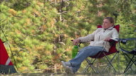 MS, USA, California, Shaver Lake, Woman relaxing in forest