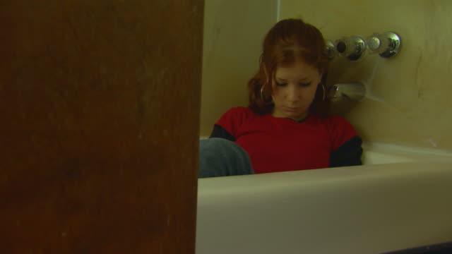 California, YosemiteGirl Sitting in Bath Tub