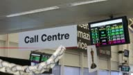 A Call Centre sign hangs inside the customer service call center at First Direct bank the online and telephone banking unit of HSBC Holdings Plc in...
