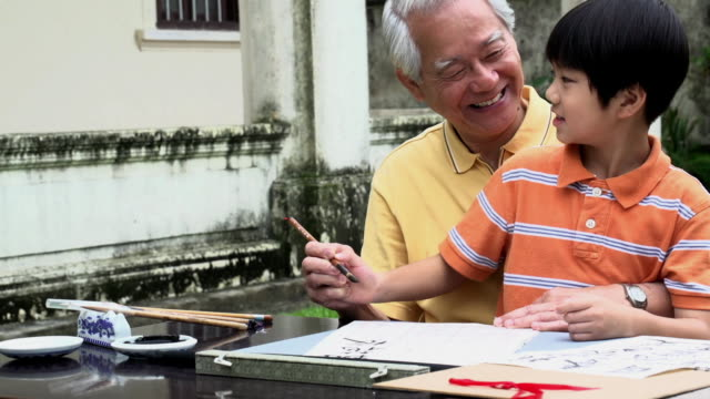 Calligraphy Grandfather and Grandson Writing