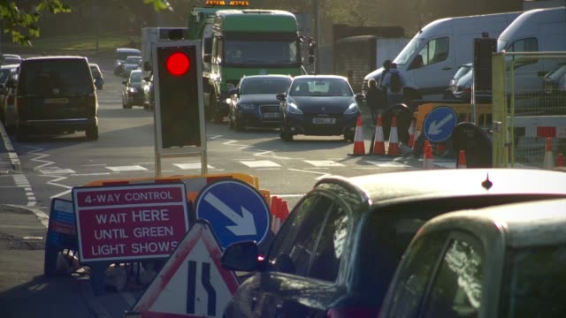 Calls for tougher rules on overrunning roadworks ENGLAND Birmingham EXT Low angle shot road traffic sign PAN roadworks Digger by roadworks Various...