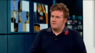 Calls to keep poppy installation at the Tower of London for longer period ENGLAND London GIR INT Paul Cummins LIVE STUDIO interview SOT ITN LIB / ITN...