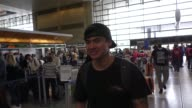 INTERVIEW Calum Hood from 5 Seconds Of Summer talks about Snapchatting on the toilet while departing at LAX Airport in Los Angeles in Celebrity...