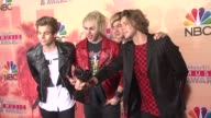 Calum Hood Michael Clifford Luke Hemmings and Ashton Irwin of 5 Seconds of Summer at the 2015 iHeartRadio Music Awards Press Room at The Shrine...