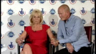 Cambridgeshire couple win EuroMillions jackpot ENGLAND Hertfordshire Hatfied PHOTOGRAPHY *** Dave and Angie Dawes spraying champagne at photocall INT...