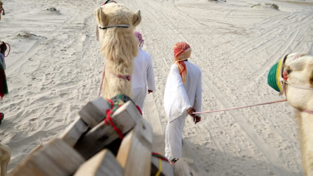 Camel riding in traditional clothing in the desert of Doha Qatar 4K resolution