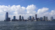Camera captures New Jersey waterfront high-rise buildings and cloud above the buildings from Manhattan.