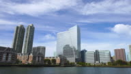 PAN Camera captures New Jersey waterfront high-rise residential buildings. Manhattan skyscrapers can be seen at opposite shore of Hudson River.