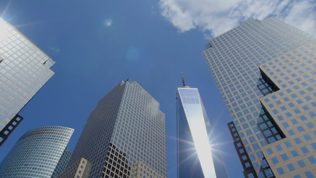 TU Camera captures One World Trade Center and skyscrapers at World Financial Center.The sun illuminate One World Trade Center.