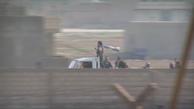 Camera follows pickup truck filled with armed Syrian rebels across the border with Turkey