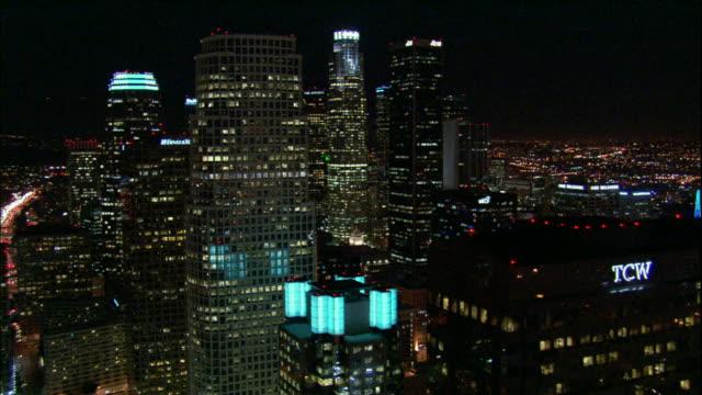 Camera glides into and through downtown LA skyscrapers.