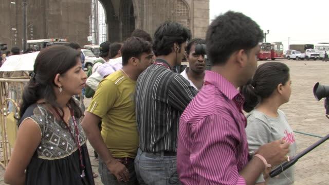 Camera operators filming Taj Hotel following terror attacks Mumbai India