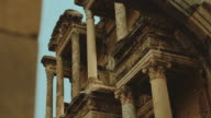 Camera pan around ancient architecture in Library of Celsus