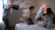 (HD1080i) Cameraman Shooting Young Couple Pillow-fighting
