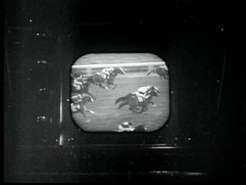 1945 B/W MONTAGE Cameramen film start of horse race. Two men watch race on TV at home. Mayor LaGuardia throws out baseball. NBC camera on tripod. Red Ruffing bats. Madison Square Garden. Golden Gloves boxing. Congress clapping / New York City / AUDIO