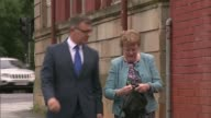 Brother admits murder SCOTLAND Glasgow EXT David and Catherine Logan along street