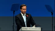 Cameron speech at 9th World Islamic Economic Forum ENGLAND London Excel Centre INT Indonesian representative and Hamid Karzai sitting on stage / '9th...